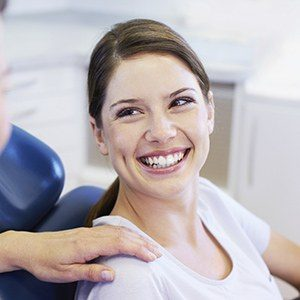 Lady in dental chair smiling