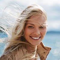 Lady with hair flowing in the wind smiling