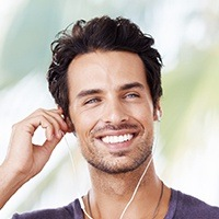 Suave man with earbuds smiling