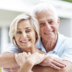 Huntington Beach Restorative Dentistry Elderly Couple smiling contently