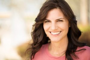 Woman smiling with dental implants in Huntington Beach