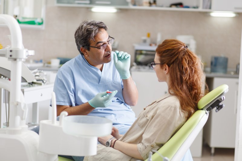 Dentist in Huntington Beach talking to patient