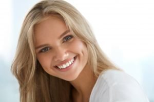 Woman's beautiful smile after visit to cosmetic dentist in Huntington Beach